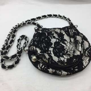 ** Karen Miller lace crossbody bag
