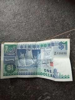 $1 old singapore money