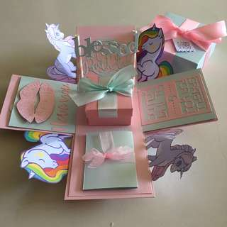 Pony explosion box with gift box , pull tab in pastel blue & pink