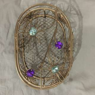 Gold wire case with stones