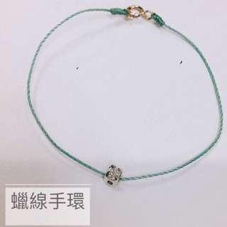 Wax string bracelet