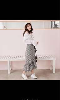 Asymmetrical checked skirt