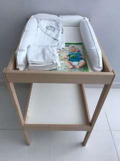 Ikea changing table, baby care mat and H&M baby towel with hood