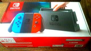 Nintendo Switch with Red/Blue Joystick Controller (Good Condition)