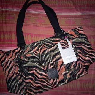 Brandnew Kipling sling/hand bag