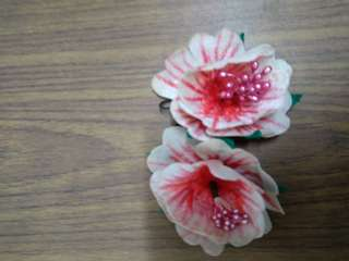 Pair of handmade flowers