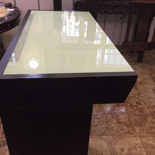 Desk with glass surface , build in light and lots of storage space
