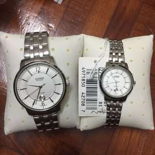 casio beside couple