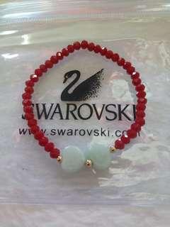 Swarovski and jade charm bracelet with 10karat gold
