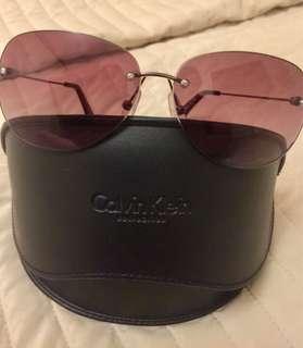 Calvin Klein Rimless Aviator Sunglasses