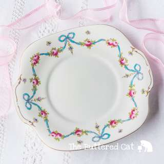 Stunning vintage English china cake plate, blue ribbon bows and pink rose swags