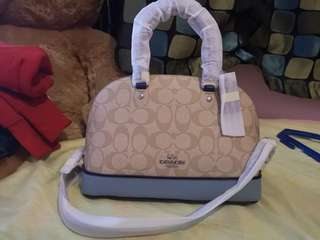 Coach Siera Mini in light blue and signature perforated leather