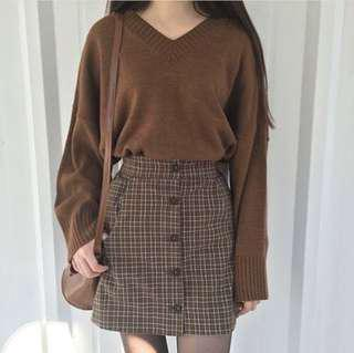 Brown v-neck knit jersey