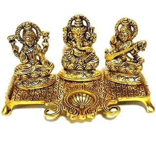 Golden metal Statue of Lord Ganesha deity Laxmi and Sarswati