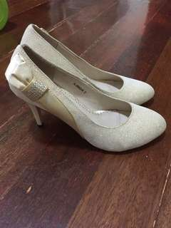 Gold shoes size 7