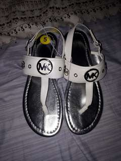 Authentic and Original Michael Kors silver and white sandals