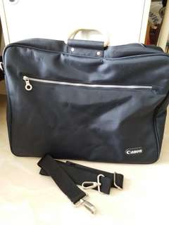 CANON brief case.can be use as traveling bag. Size: 17   X  13  inch