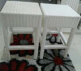 White imported Rattan stools.