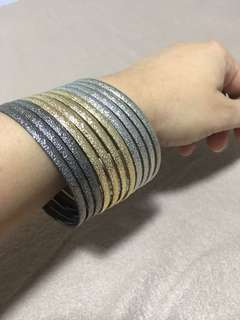 Stackable bangles in gold, silver and gray