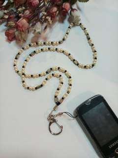 Id badge and celphone holder lanyard