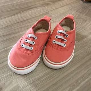 Orange plimsole kid shoes