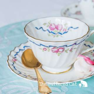 Beautiful vintage ribbons and roses English china cup and saucer, for the collector