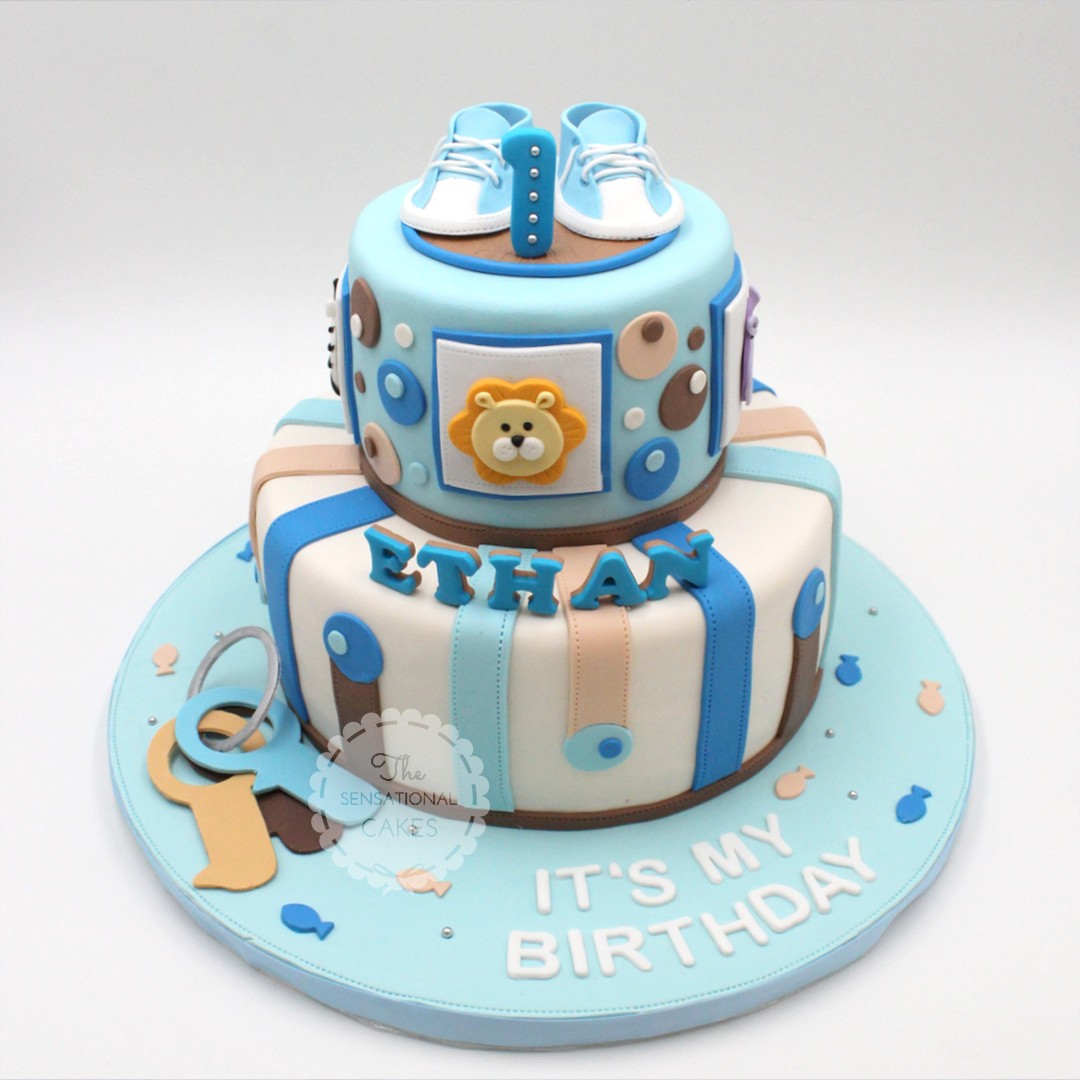 Baby Boy theme cake with baby shoe, pastel circle and ...