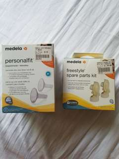 BNIB Medela freestyle spare parts kit and medela breastshields size 21. NEW. Never used. Regiftable. Pick up Beaches or Yorkville. Purchased both for $50. Take both for half that.