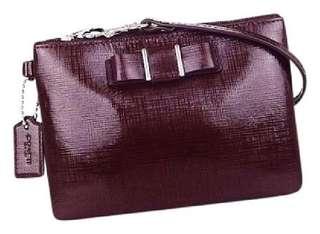 New, Authentic Coach F52137 Darcy Patent Bow Small Wristlet Handbag (Sherry/Burgundy)