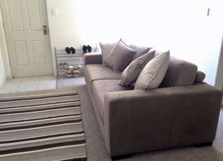 4 person Sofa with 4 matching cushions and foot rest with storage