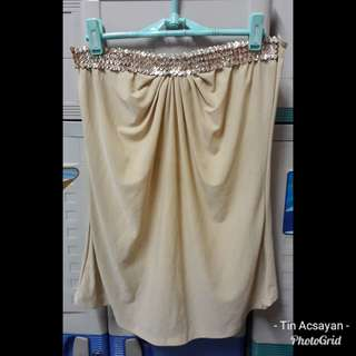 Skin tone tube top with gold sequins
