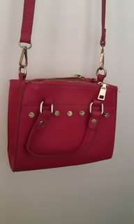 Pink leather cross-body bag