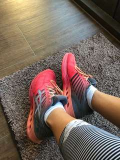 ASICS pink / peach / salmon runners