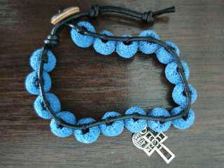 Blue volcanic stone bracelet with Christine cross