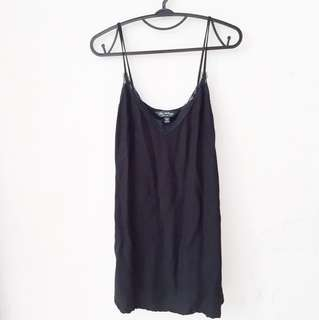 Black slip dress with lace neckline