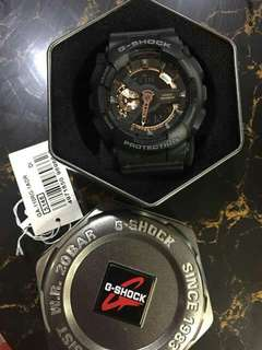 Gshock black and gold watch