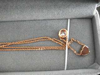 Rose gold diamond heart necklace amulet
