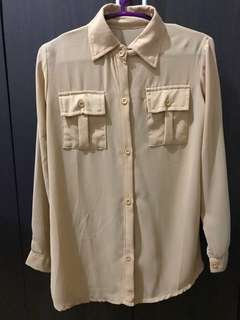 Flesh colored buttoned down blouse / polo