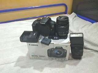 Canon 1300D with 18-55 mm F 3.5 III .