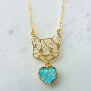 Geometric cat with blue heart necklace