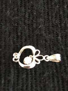 White Gold 9k Pendant 1.3 gm with a single small diamond
