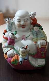 Cream laughing buddha