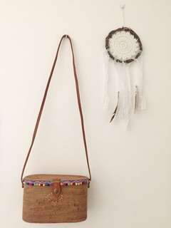 Oval rattan bag with leather strap