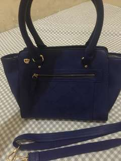 Blue sling/shoulder bag