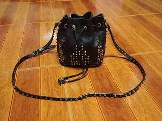 Christian louboutin studded mini drawstring bucket crossbody bag