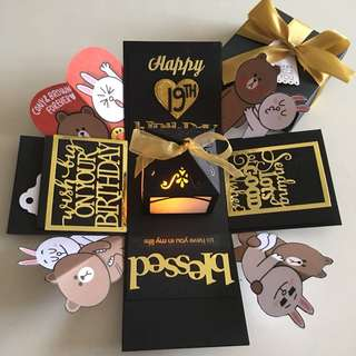 Brown and cony explosion box with lighthouse and 4 personalised photos in black and Gold