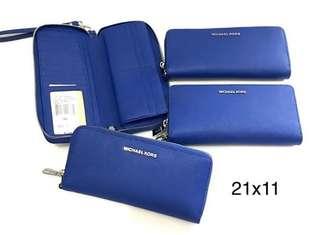 mk js trvl continetal wallet electric blue sz 21x11