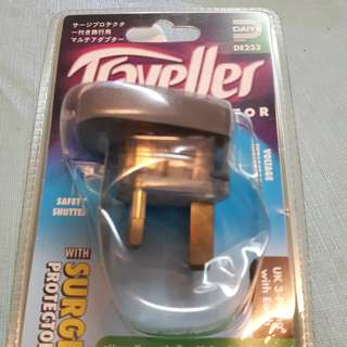 Two pieces of traveller's adaptor