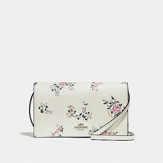 FOLDOVER CROSSBODY CLUTCH WITH CROSS STITCH FLORAL PRINT. Style no. 25797