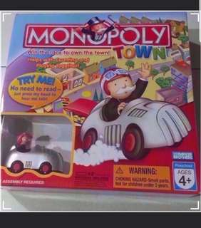NEW. Monopoly Town Board Game with battery operated moving car & Track. ( Car will move by itself ) :)  Great for Gift / Birthday Gift :) +FREE Children Books etc..